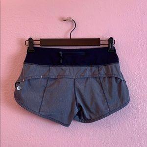 Lululemon Athletica navy blue and white shorts